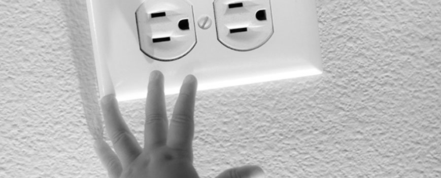 hand-reaching-to-outlet
